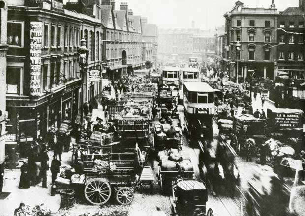 Commercial Street Spitalfields busy with horses and carts in 1888.