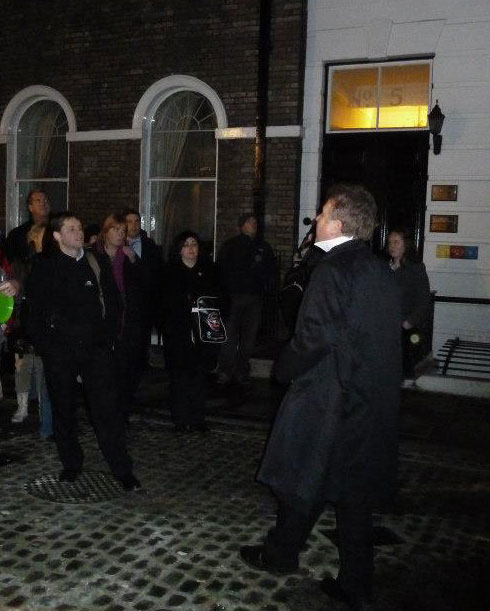 A group listening to Richard Jones tell a story on the ghost walk.