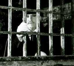 Richard looking through the cell bars at the House of Detention.