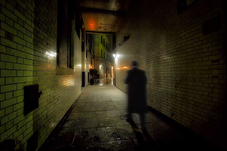 Richard Jones walking through an alleyway.