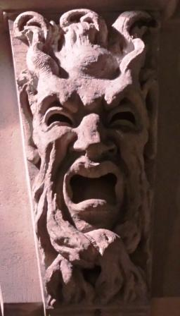 A stone face twisted in terror.